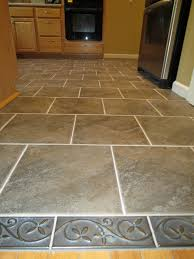 Kitchen Designs Unlimited by Brown Square Tile Plus Rectangle Gray Tile With Golden Leaves