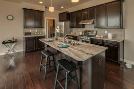 Graphite Kitchen Cabinets White Granite With Bordeaux Finish Cherry Cabinets And Mixed Brown