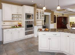 Kitchen With Cream Cabinets by Winter White Walnut Glaze Cabinets With A Granite Countertop