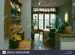 French Doors Dining Room by China On Pine Shelves Above Terracotta Tiled Worktop In Openplan