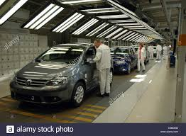 new volkswagen car dpa volkswagen car mechanics inspect golf models of the new