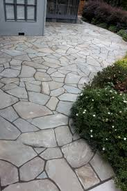 Dry Laid Bluestone Patio by I Would Like To Cover The Ugly Concrete Patio With Stone Or Tile