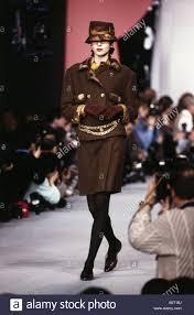 fashion 1990s mannequin wearing miniskirt and jacket catwalk