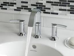bathroom with modern stainless steel faucet finding the best