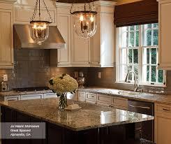off white glazed cabinets and dark kitchen island kitchen craft