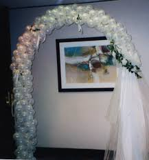 wedding arches using tulle weddings blossom balloon artist