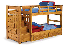 brown stained wooden teenage bunk bed built in stairs and drawers