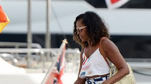 michelle obama rocks a leggy look and bares her midriff during