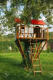 cute small tree house for kids on backyard german style stock