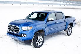 lexus of tacoma staff watch the 2016 toyota tacoma dig its way out of deep sand