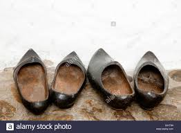 two pairs of wooden shoes stock photo royalty free image