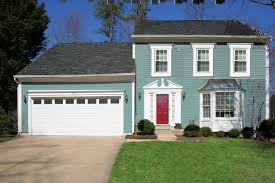 house with portsmouth blue white wide trim and no shutters red