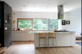 photo 8 of 9 in gable roofed rural weekend home in connecticut dwell in the kitchen a sirius range hood hovers over a wolf cooktop the bleached