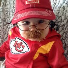baby dressed as kansas city chiefs head coach andy reid is the