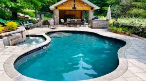 architecture contemporary pool design with stone wall fence and