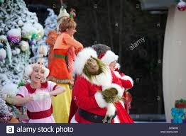 the grinch performing with the whos in whoville at grinchmas at