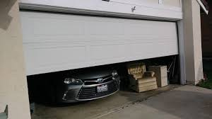 can you use an existing door for a barn door can you make an existing garage door automatic