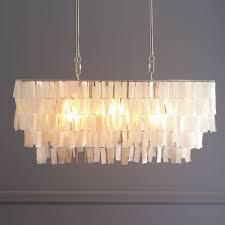 large rectangular capiz shell chandelier casts a gentle