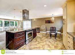 beautiful kitchen island with granite top and hood stock photo