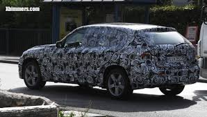 newest bmw x1 spyphotos with mostly only camo paint