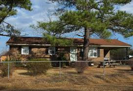 Decorating A Ranch Style Home by Brick Ranch Style Home With Carport Under Pine Trees Between