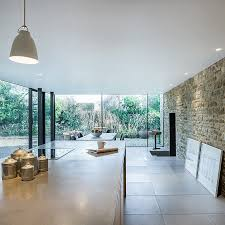 17th century british cottage gets a glassy modern extension view in gallery elegant modern kitchen and dining room inside the new extension