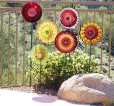 garden art from junk dishes yet another plate flower backing