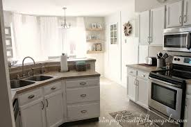 Behr Paint Kitchen Cabinets Simply Beautiful By Angela Repainting The Kitchen Cabinets Part 2