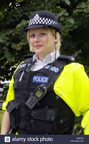 blonde female dorset policewoman wearing a stab vest on top of a