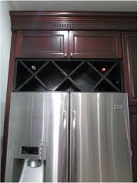 space between top of refrigerator and cabinet black and white kitchen makeover reveal wine rack anna and wine