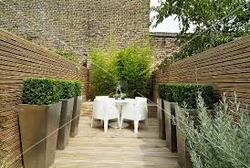 Topiary Planters - designer terrace with white outdoor furniture and topiary box
