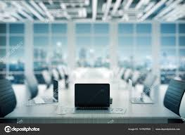 dark wood conference table laptop on conference table stock photo peshkova 141927620