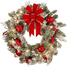 improvements indoor outdoor lighted christmas garland improvements let it snow lighted christmas wreath 30 liked on