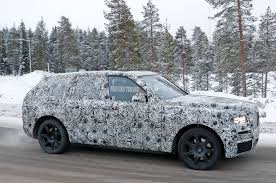 roll royce cullinan spied rolls royce cullinan shows off suv rear end motor trend