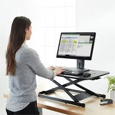 sit stand computer desk elevate your office with this 139 amazonbasics sit stand desk