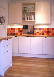 a customised kitchen with standard cabinets clad with birch ply