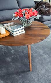 round coffee table in solid wood article amoeba modern furniture