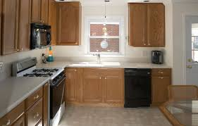 Kraftmade Kitchen Cabinets by Furniture Cozy Dark Pergo Flooring With Dark Kraftmaid Kitchen