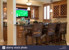 showcase residential wet bar with tv house interior usa stock
