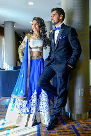 indian bride and groom in matching blue reception in