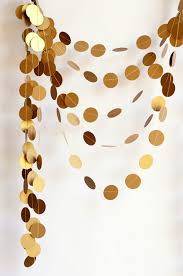 this reusable gold cardstock garland would fit right in at any of