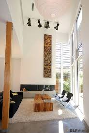 modern living room with high ceiling u0026 cement fireplace zillow