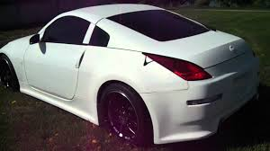 white nissan 350z 1 of a kind custom nissan 350z with flat white paint and gucci