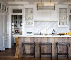 gorgeous marble wall open shelving with lots of wood accents