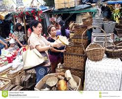 a customer inspects a home decor product at a store in dapitan