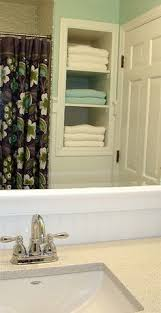 store more in your bath small bathroom wall stud and storage