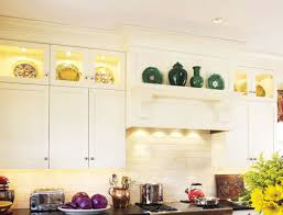 space above cabinet decorating what go on top of kitchen cabinets