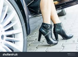 s boots with legs wearing black boots high stock photo 505019314