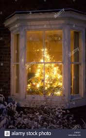 christmas tree in terrace house window stock photo royalty free