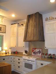 amazing wood vent hood homesfeed classic wood vent hood with white kitchen cabinet set